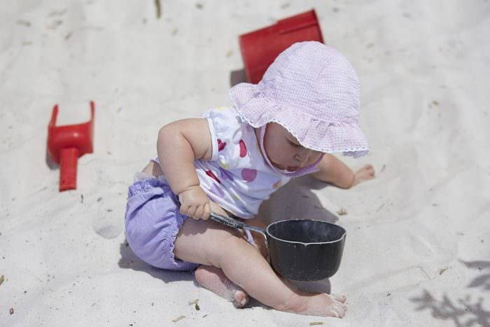 Small girl playing in sand