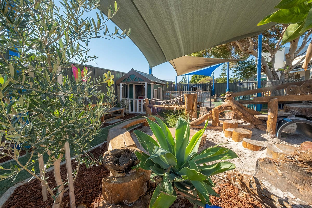 Toddler outdoor environment trees and sandpit with wooden play structures at Keiki early learning mindarie keys