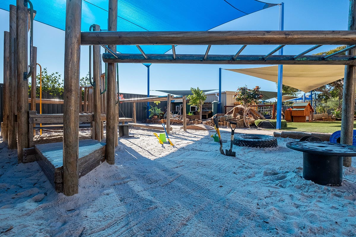 Kindy outdoor environment sandpit with wooden monkey bars at Keiki early learning mindarie keys