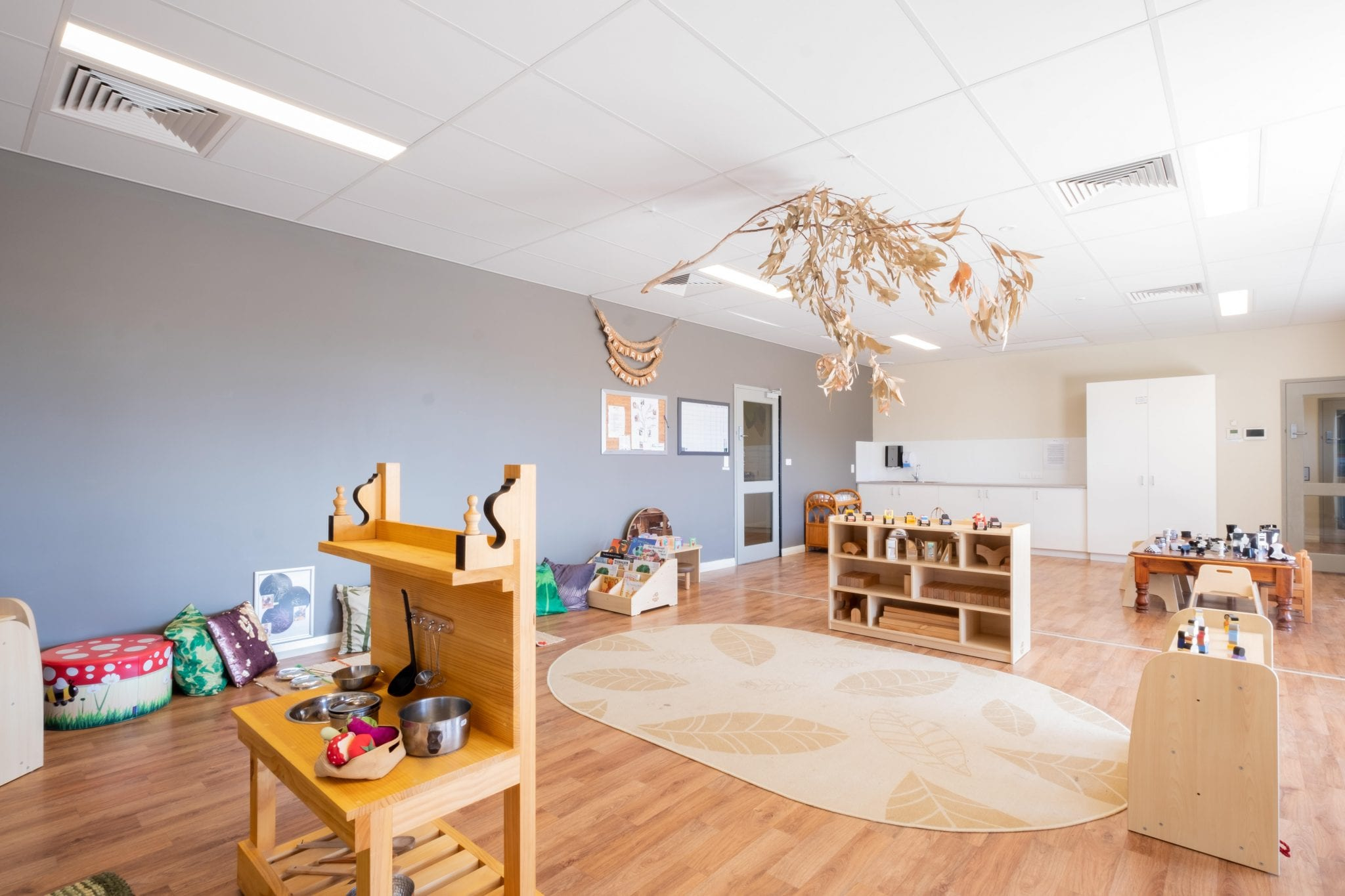 Toddler indoor environment with wooden furniture and play kitchen at keiki early learning trinity alkimos