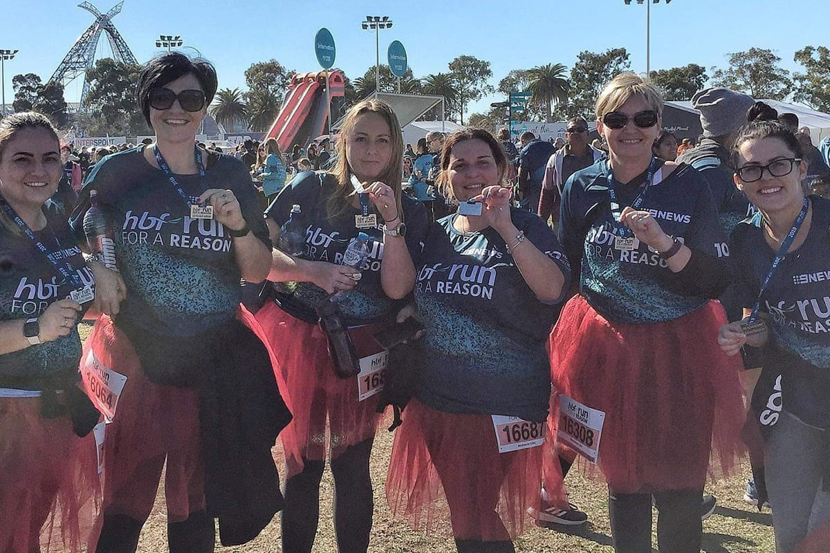 six-women-from-keiki-early-learning-trinity-at-hbf-run-for-a-reason-holding-their-medal