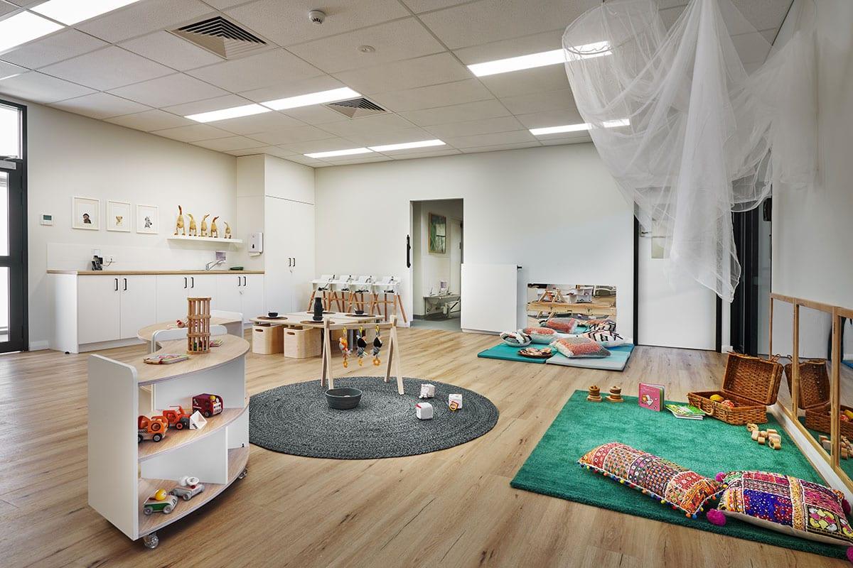 Keiki Edgewater spacious nursey room with white interior and kids toys