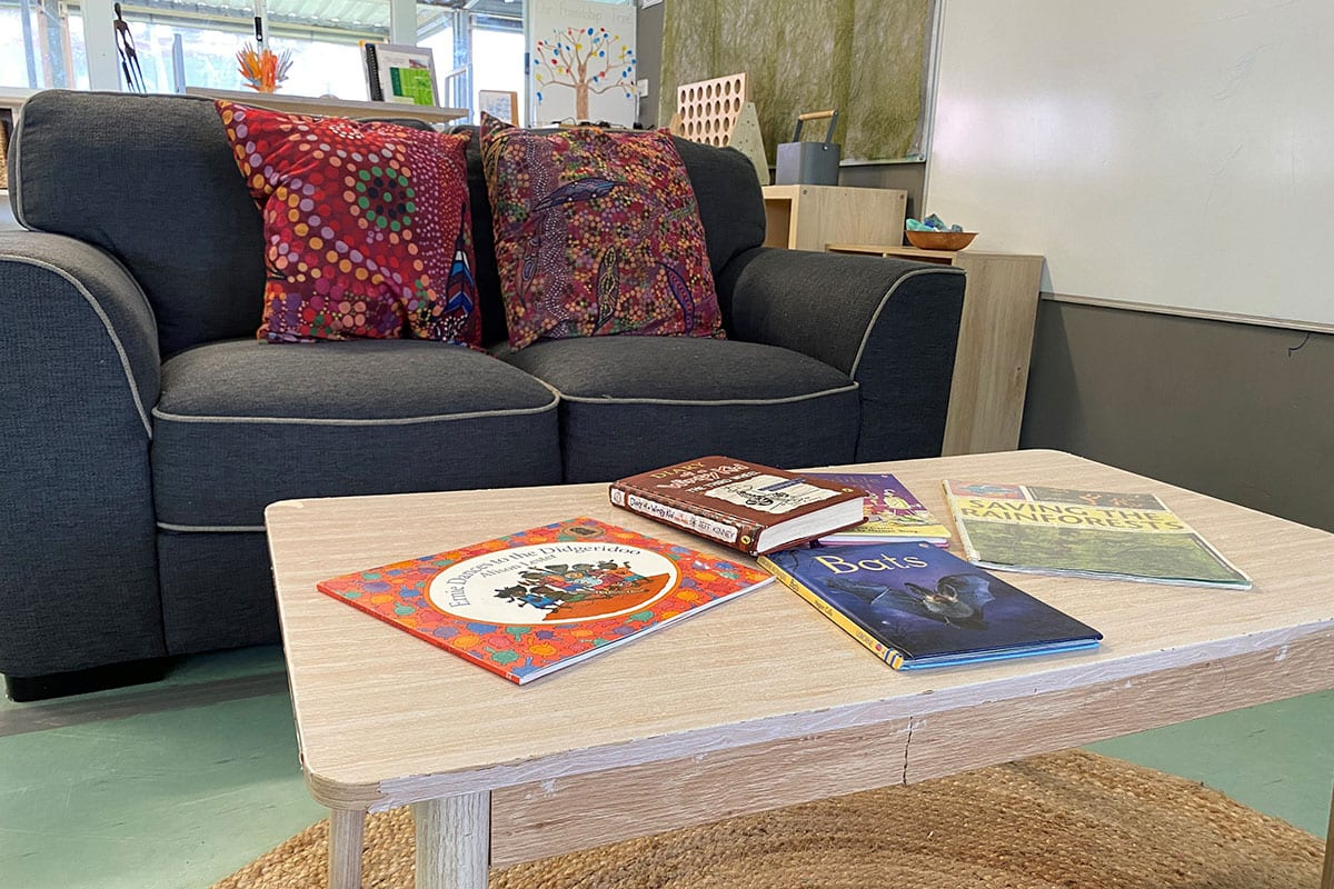 sofa with childrens books on coffee table