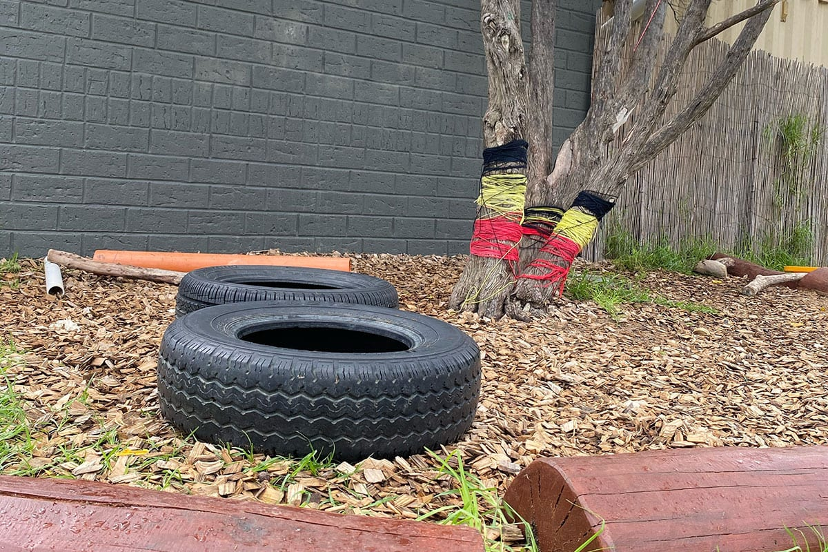 tires and logs on ground outdoors