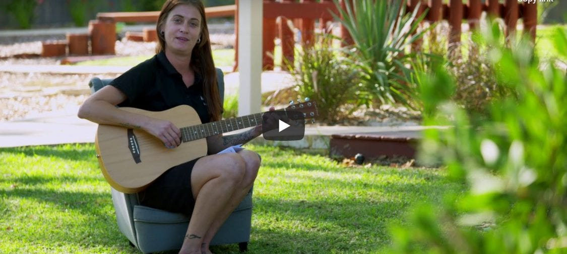 Bree from Keiki Early Learning Performing Wanjoo The Welcome Song sitting in the opening lawn