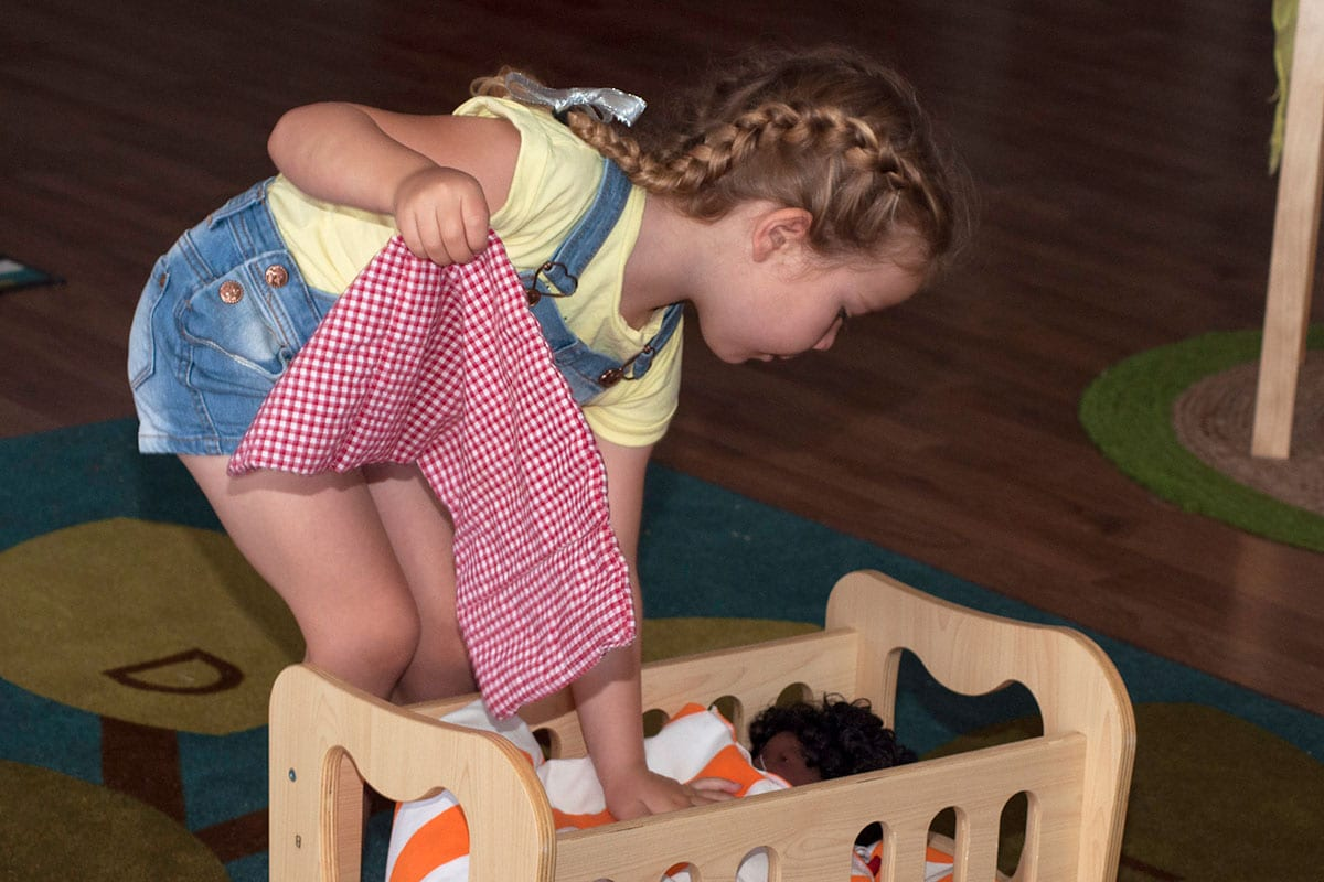 Small girl playing with her doll at Keiki Early Learning Centre