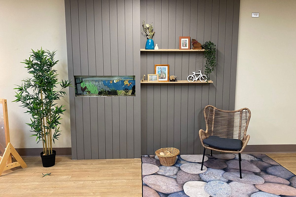 Interior of toddler daycare with fish tank wall on display